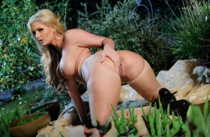 Chubby MILF in pantyhose Phoenix Marie showing her big tits outdoor
