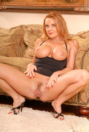 Mature babe Janet Mason on high heels teases her hairy cunt