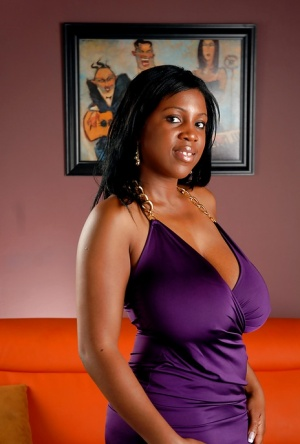 Black babe Maseratti showing her huge melons and young pussy