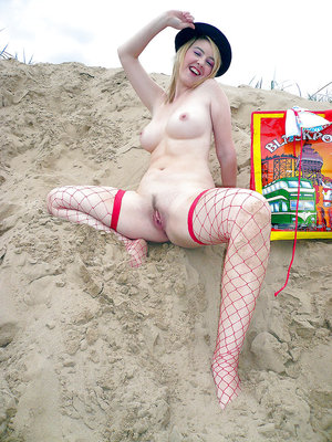 Young babe in fishnet stockings Katie flashing and posing in the streets