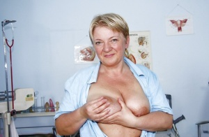 Chubby granny with huge flabby tits teasing her hairy cunt