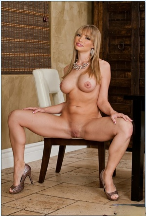 Seductive babe Maya Hills showing her huge melons and her shaved pussy