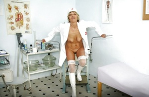 Busty mature nurse spreading her legs and teasing her shaved cunt