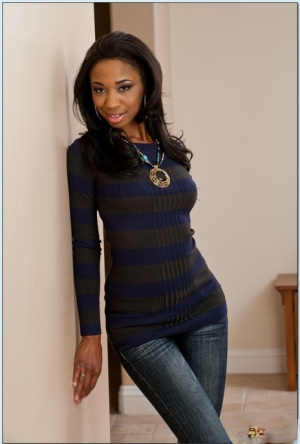 Tempting ebony babe Jade Nacole taking off all of her clothes