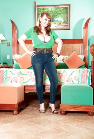 Sexy MILF on high heels Micky Bells exposing her whopping boobs
