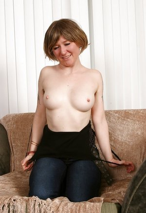 Busty babe with hairy armpits pulling off her jeans and panties