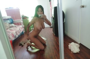 Gorgeous brunette babe Anissa Kate stripping and posing nude