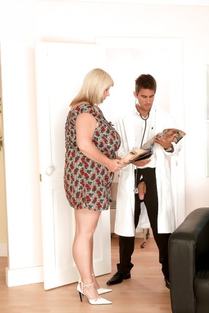 Big breasted blonde fatty gave her handsome doctor a good handjob in his office.