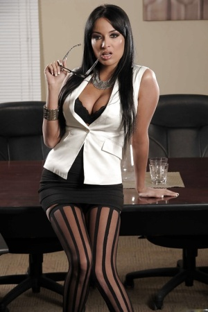 Hot babe in glasses Anissa Kate uncovering her tempting curves in the office