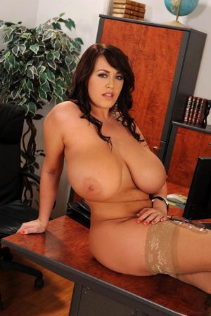 Busty brunette MILF Leanne Crow stripping off her clothes in the office