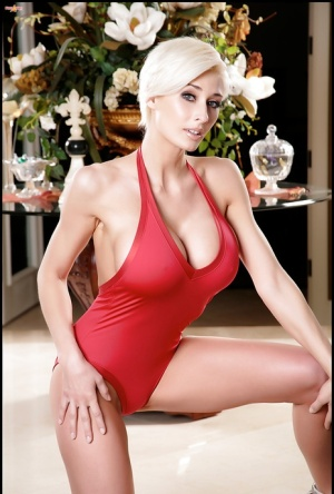 Short haired blonde babe in red swimsuit showing off her big tits