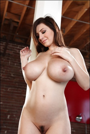 Curvaceous babe September Carrino showing off her bare sexy body