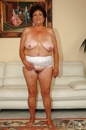 Fatty granny in lingerie gets naked to show her wet cunt