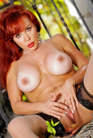 Busty redhead mature lady stripping and toying her pussy outdoor