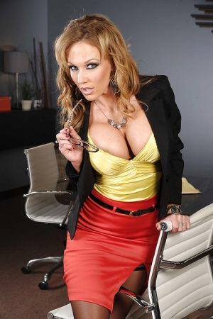 Gorgeous office babe Nikki Sexx uncovering her voluptuous curves