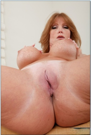Mature redhead Darla Crane brings out round tits and spreads pink