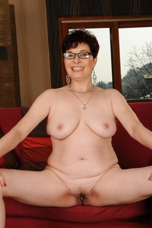 Short haired brunette granny on high heels stripping and spreading her legs