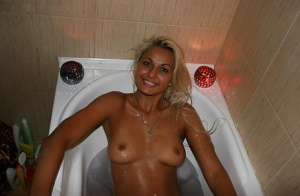 Stunning amateur blonde taking a bath and exposing her sexy body