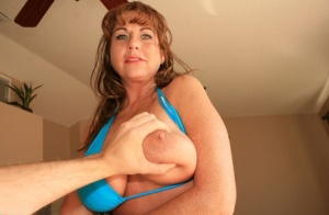 Naughty MILF in bikini lets lucky guy to play with her big tits