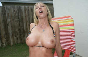 Big busted MILF gives a great tugjob and gets bukkaked outdoor