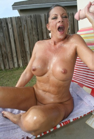 Lustful mature brunette gives a blowjob and gets bukkaked outdoor