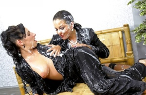 Fully clothed chicks on high heels are into messy action with fake jizz