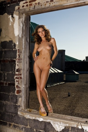 Foxy babe with long legs and neat fanny Marlena Dee stripping outdoor