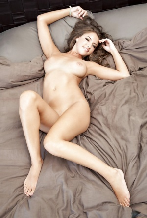 Voluptuous brunette babe Jessica Workman stripping on the bed