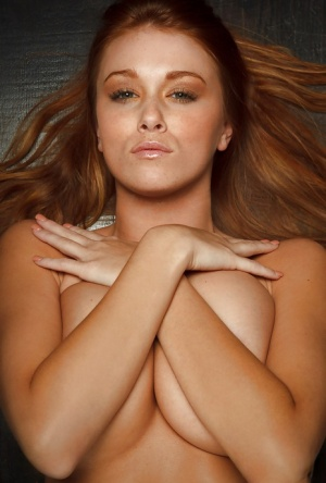 Big busted redhead babe Leanna Decker taking off her lingerie