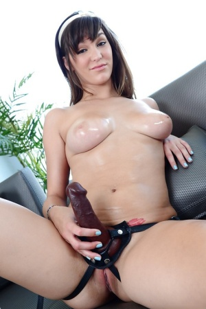 Petite babe with big tits Holly Michaels posing wearing strapon