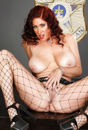Busty MILF in fishnet pantyhose Tiffany Mynx stripping off her clothes