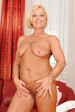 Fuckable blonde granny stripping and showcasing her hairy twat