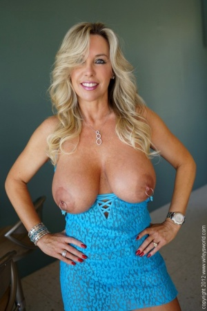 Petite blonde wife on high heels uncovering her big jugs with pierced nipples