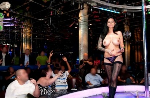 Steaming hot pornstar with big round bosoms performs a hot striptease
