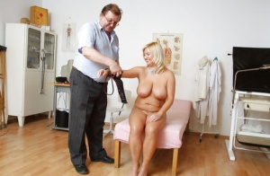 Buxom mature blonde gets her cunt stretched by gynos fingers and tools