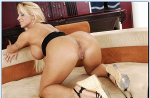 Hot MILF Holly Halston uncovering her gorgeous curves and teasing her cunt