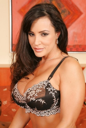 Lisa Ann has some interracial hardcore fun with a studly black lad
