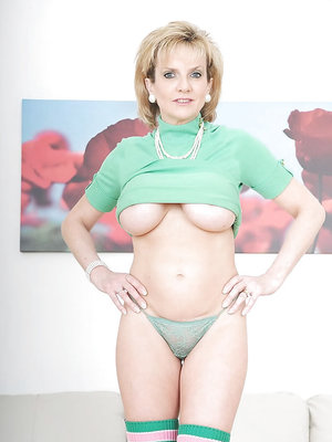 Mature fetish lady in cotton stockings uncovering her shapely big tits
