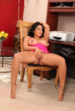 Hot MILF Kiara Mia uncovering her round jugs and taking off her panties