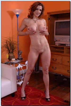 Foxy mature gal in blue jeans Christina Noir uncovering her tempting curves