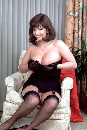 Chubby fatty Aspen Alps denudes tits and poses in black stockings