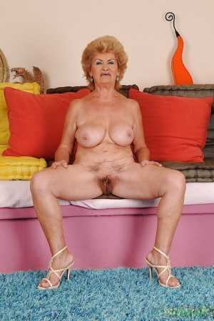 Juggy granny with ugly face undressing and expposing her shaggy cunt
