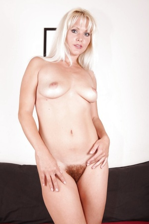 Sexy MILF Kathy Anderson undressing and exposing her bushy cunt in close up 90086510