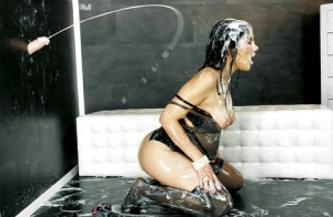Sassy chick has some gloryhole fun and gets completely glazed with fake jizz