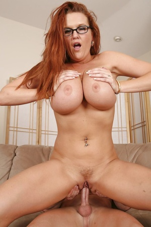 Busty redhead MILF in glasses Kitty Lynxxx gets fucked and facialized
