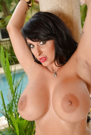 Curvaceous brunette MILF Holly Halston taking off her dress and lingerie