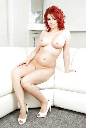 Redhead MILF slipping off her sexy lingerie and spreading her legs