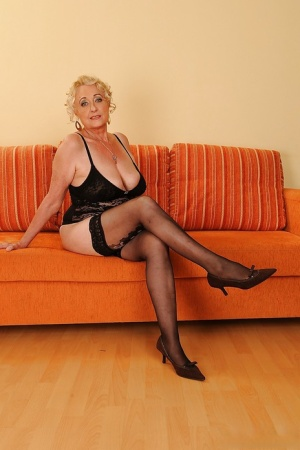 Naughty granny with flabby curves and hairy gash taking off her lingerie