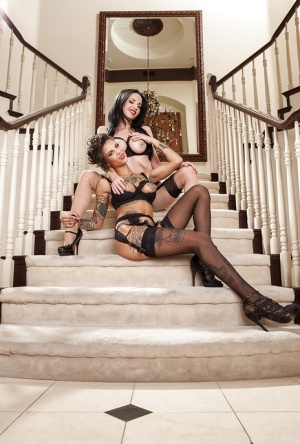 Kicky raven-haired vixens have some lesbian humping fun on the stairs