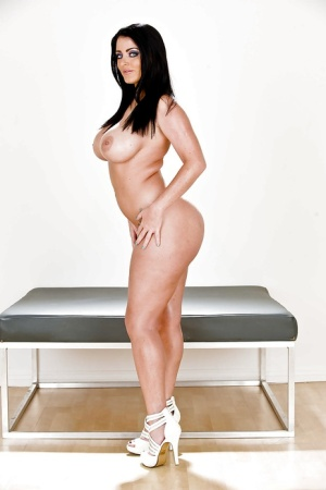 Curvaceous brunette lady Sophie Dee undressing and exposing her goods